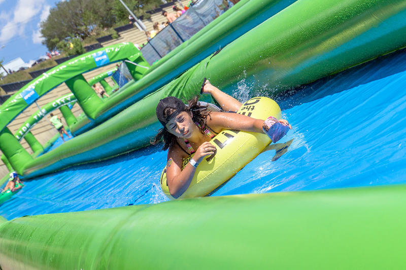 A female rides down the slide at Slide The City.