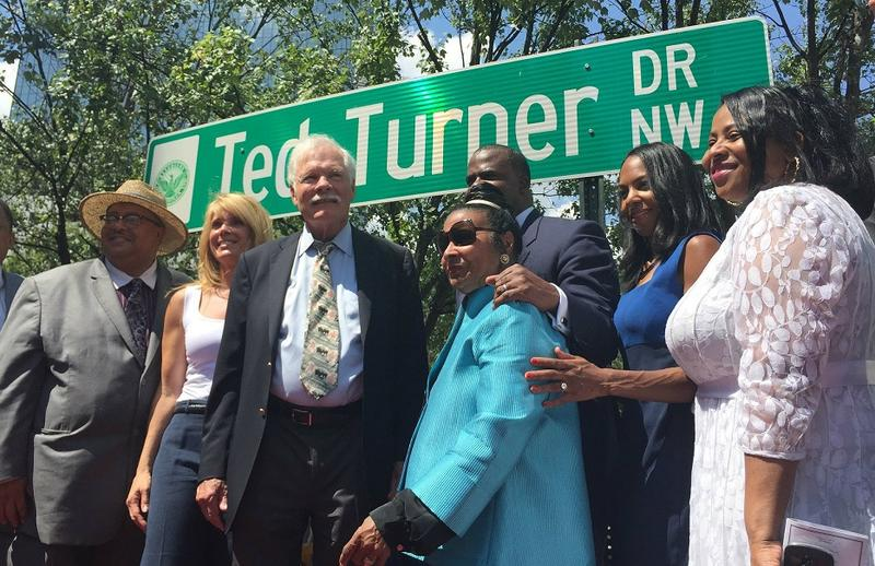 Ted Turner stands with his daughter, civil rights leader Xernona Clayton and Atlanta City Council members Tuesday during a ceremony to unveil Ted Turner Drive.