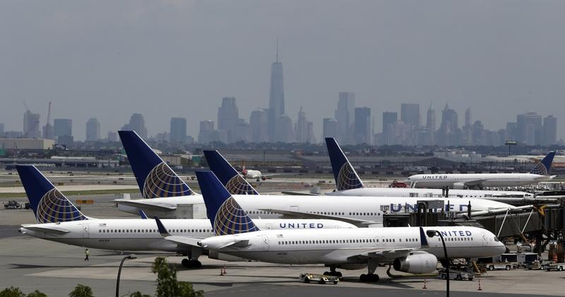FILE - In this Tuesday, July 22, 2014, file photo, United Airlines jets are parked on the tarmac at Newark Liberty International Airport, in Newark, N.J. All United Continental flights in the U.S. were grounded Wednesday morning, July 8, 2015, due to comp