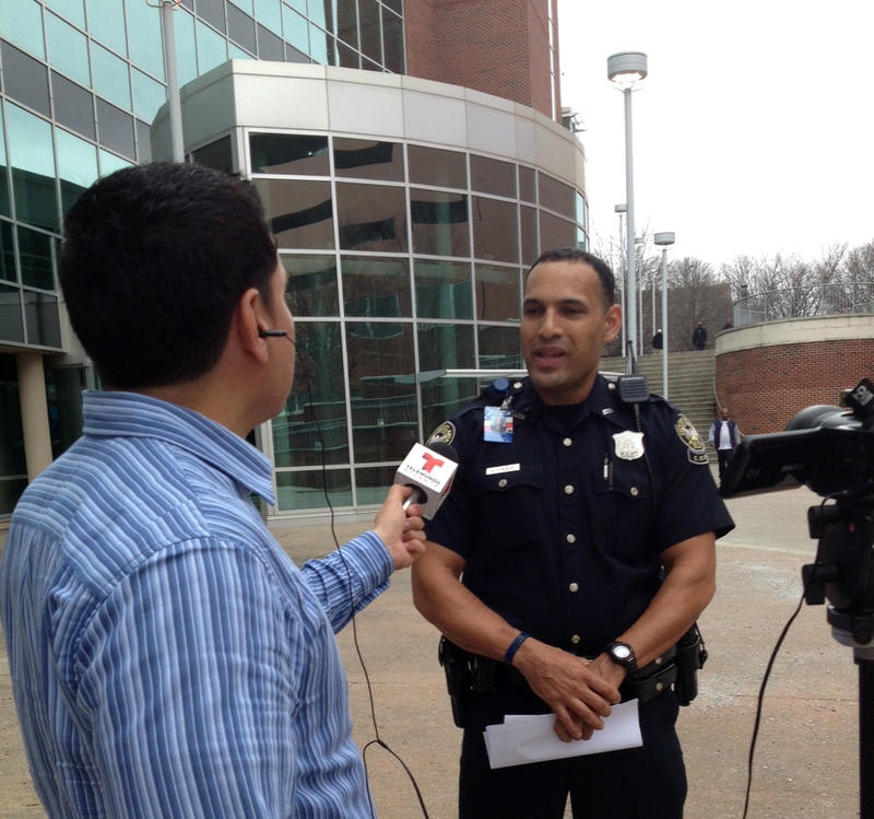 Officer Antonio Gonzalez, seen here speaking to a local Spanish-language television network, formerly served as APD's Hispanic liaison. While the department employs a good number of Spanish speaking officers, it still needs to hire many more to reflect At
