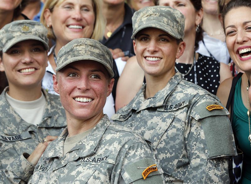 U.S. Army First Lt. Shaye Haver, center, and Capt. Kristen Griest, right, pose for photos with other female West Point alumni after an Army Ranger school graduation ceremony, Friday, Aug. 21, 2015, at Fort Benning, Ga. Haver and Griest became the first fe