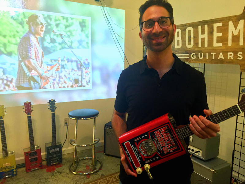 Shaun Lee, co-founder of Atlanta-based Bohemian Guitars, holds the company's newest product--a ukulele