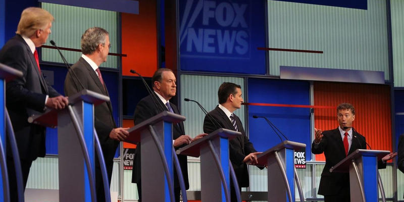 Republican presidential candidates from left, Donald Trump, Jeb Bush, Mike Huckabee, Ted Cruz and Rand Paul take the stage for the first Republican presidential debate at the Quicken Loans Arena Thursday, Aug. 6, 2015, in Cleveland.