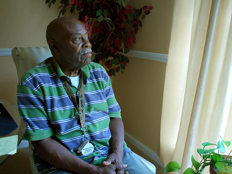 Robert Davis looks out of the window of his Johns Creek home.