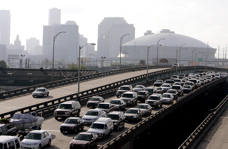 Vehicles leave New Orleans ahead of Hurricane Katrina on Sunday, Aug. 28, 2005. The Category 5 storm is expected to make landfall on Monday.