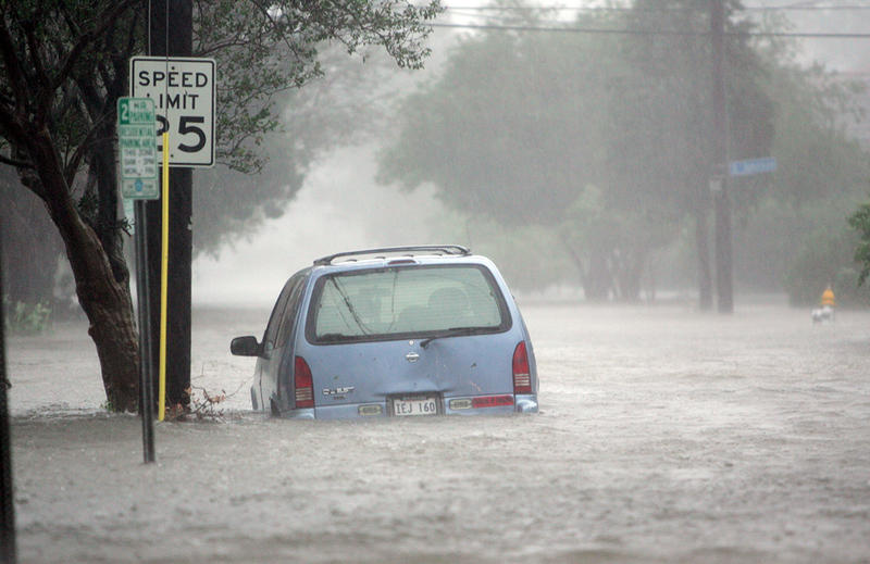 Floodwaters surround a car in uptown New Orleans early Monday, Aug. 29, 2005 as high winds and rain batter the Louisiana coast as Hurricane Katrina makes landfall.