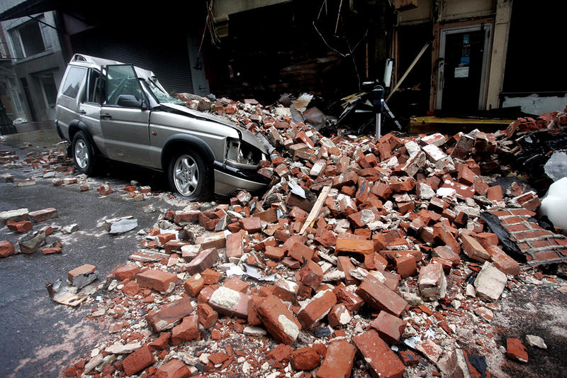 An SUV is seen crushed by bricks after  Hurricane Katrina hit New Orleans,  Monday Morning, Aug. 29,  2005.