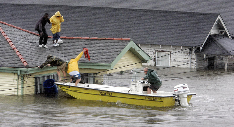 Bryan Vernon and Dorothy Bell are rescued from their  rooftop after  Hurricane Katrina hit, causing flooding in their New Orleans neighborhood on Aug. 29, 2005.