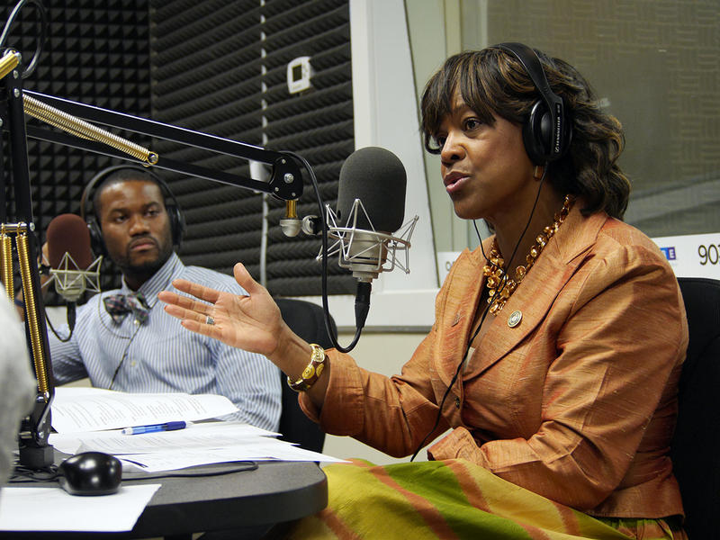 Dr. Valerie Montgomery Rice, right, President of Morehouse School of Medicine, talks about the decline of African-American males in medicine, while Dr. Benjamin Renelus, a third year internal-medicine resident listens.