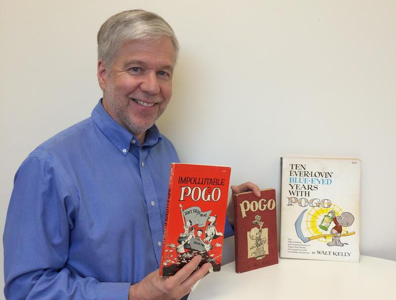 Denis O'Hayer with three Pogo books from his collection