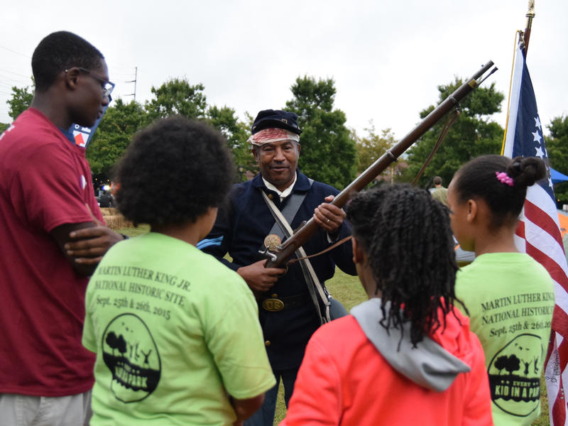 Robert Philips a reenactor from the 44th Regiment US Colored Troop demonstrates one of the rifles used during the Civil War.