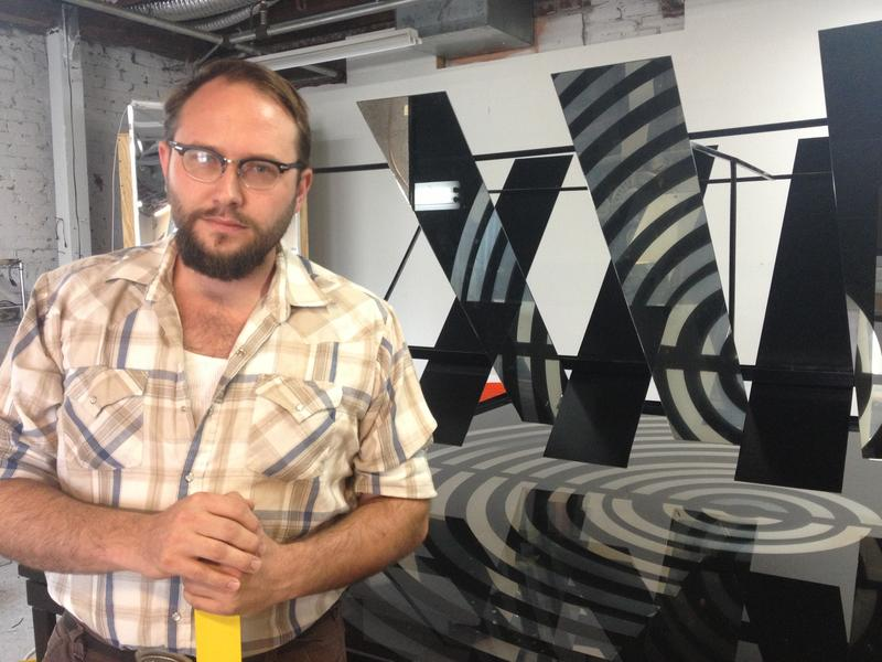 "Dana Haugaard with his sculpture and sound piece ""No Here More Than Here"" in his studio at the Atlanta Contemporary Art Center."
