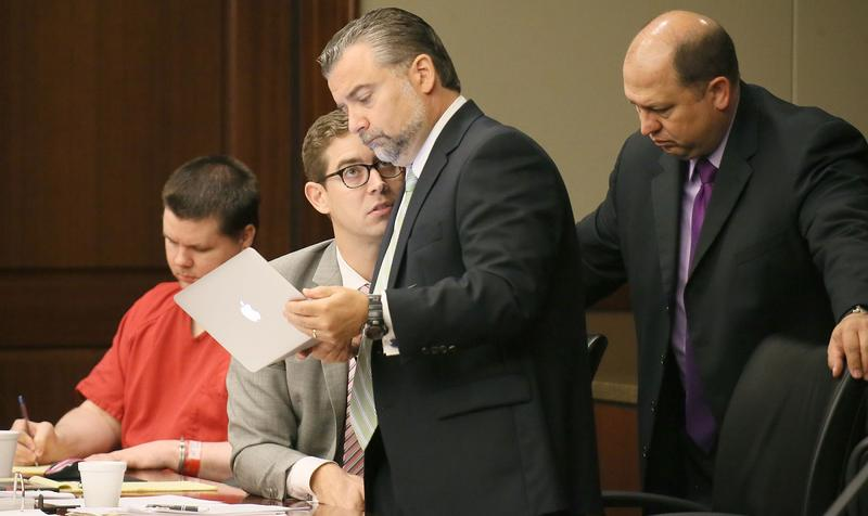The defense team of Justin Ross Harris, attorney's Carlos Rodriguez, center left, Maddox Kilgore and T. Bryan Lumpkin, right,discuss information in Cobb County Superior Court Judge Mary Staley's courtroom on Tuesday, Tuesday, Sept. 15, 2015, during day tw