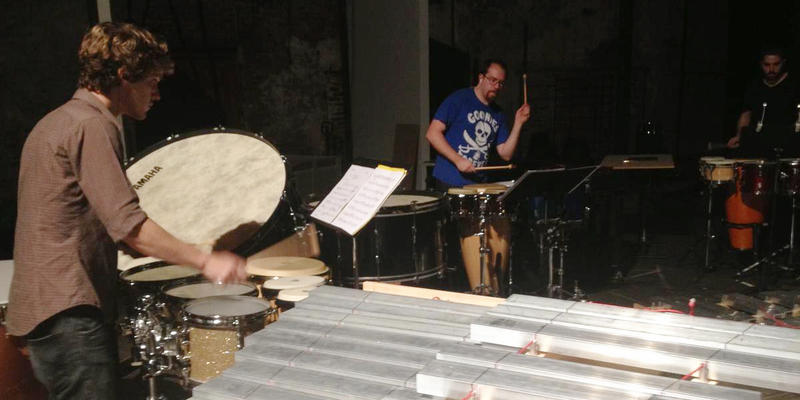 "Members of Atlanta contemporary ensemble Chamber Cartel rehearsing for their performance of Xenakis' ""Pleiades"" at the Goat Farm Arts Center."