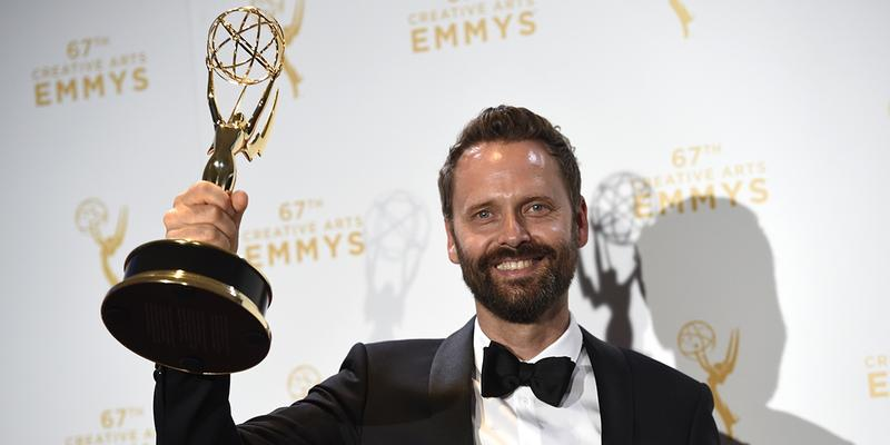 """Dustin O'Halloran, winner of the award for outstanding main title theme music from """"Transparent,"""" poses in the press room at the Creative Arts Emmy Awards at the Microsoft Theater on Sept. 12 in Los Angeles."""