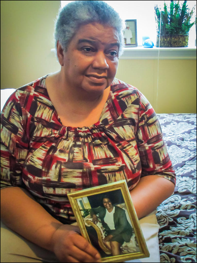 Margaret Washington's mother holds a photograph of herself in her younger years.