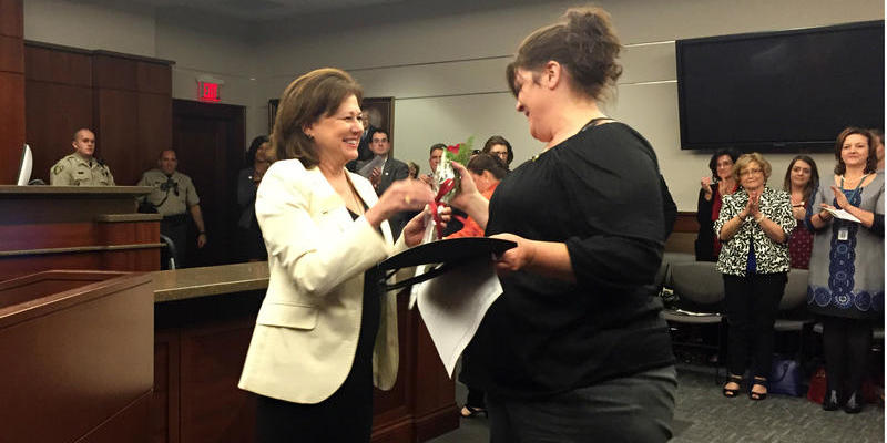 Cobb County Superior Court Judge Mary Staley, left, and Tracy Traver at the first graduation ceremony of mental health court.