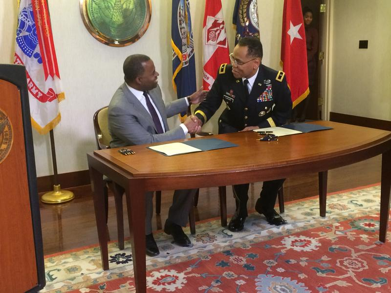Mayor Kasim Reed, left, and U.S. Army Corps Brigadier General C. David Turner, right, sign legislation authorizing the study.