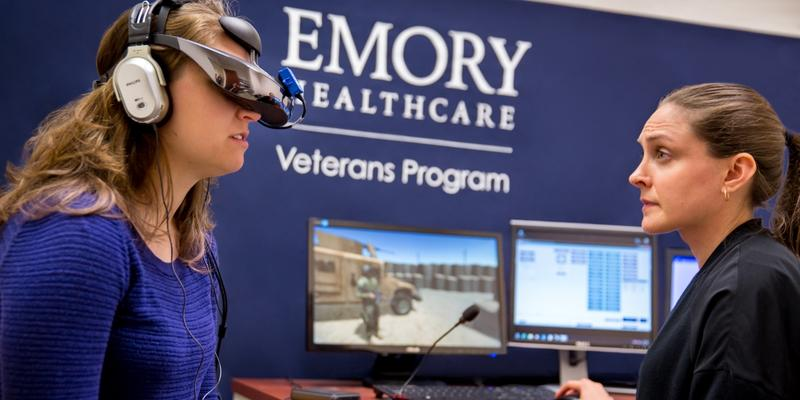 Dr. Loren Post with a patient at Emory's Brain Health Center.