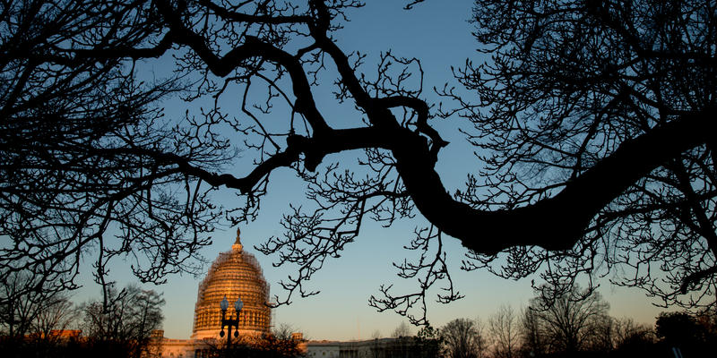 The Capitol Dome is visible at sunrise in Washington, Saturday.