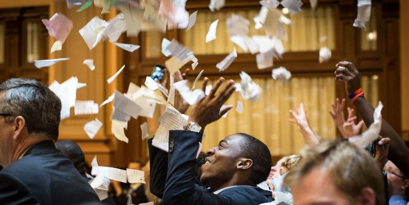 House members throw up paper at the conclusion of the legislative session in the House Chamber, Friday, April 3, 2015, in Atlanta. By law, Georgia's General Assembly meets for 40 working days each year.
