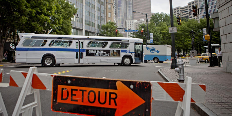 A vintage New York City bus sits parked against the backdrop of downtown Peachtree Street as the area is turned into the set for filming of the movie ''Anchorman: The Legend Continues,'' May 10, 2013, in Atlanta.