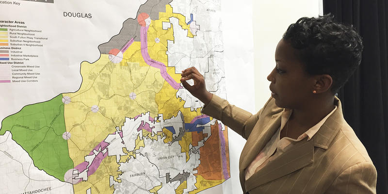Fulton County planner, Shayla Reed, describes the planning process for the city of South Fulton at a meeting in January 2016.