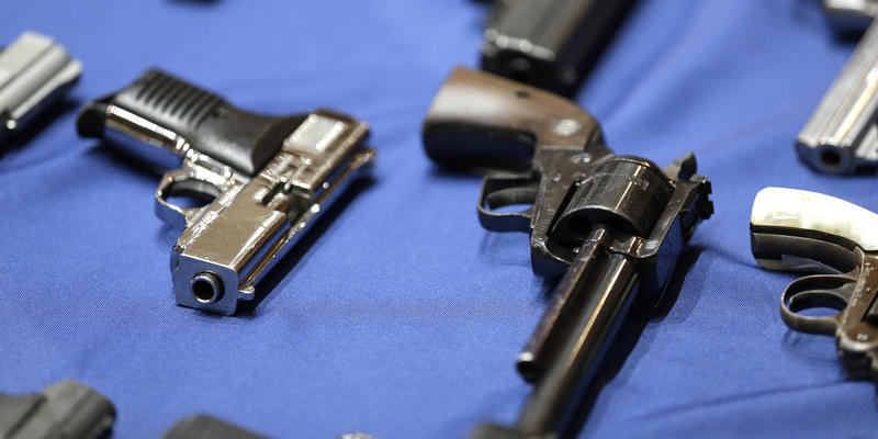 Guns seized by the police are displayed during a news conference in New York, Tuesday, Oct. 27, 2015.