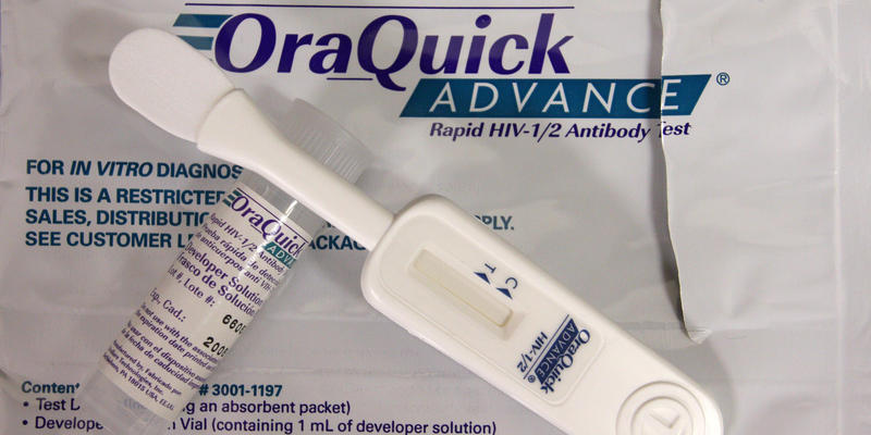 This Thursday, June 26, 2008 file photo shows a developer solution vial, left, and test device, right, for an oral rapid HIV test at a medical center in the Bronx borough of New York.