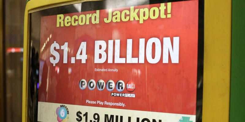 A Pennsylvania lottery kiosk promotes the record $1.4 billion Powerball Jackpot in a mini-mart in Monroeville, Pa., Jan. 11, 2015.
