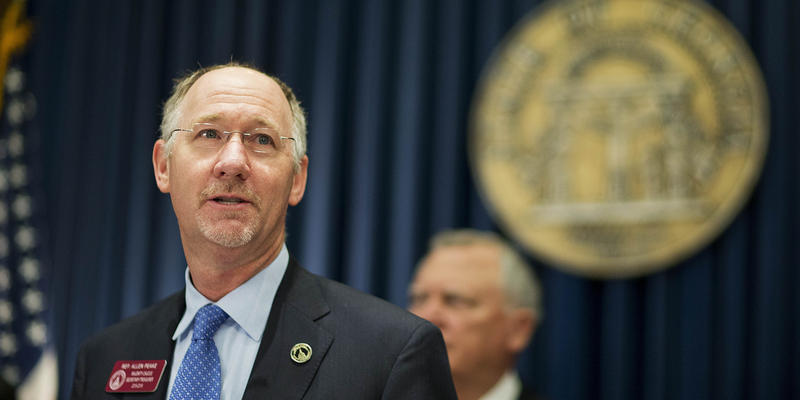 State Rep. Allen Peake, R-Macon, speaks before Georgia Gov. Nathan Deal, rear, signs an executive order requiring state agencies to start preparations now for the enactment of the state's medical marijuana bill Friday, March 27, 2015, in Atlanta.