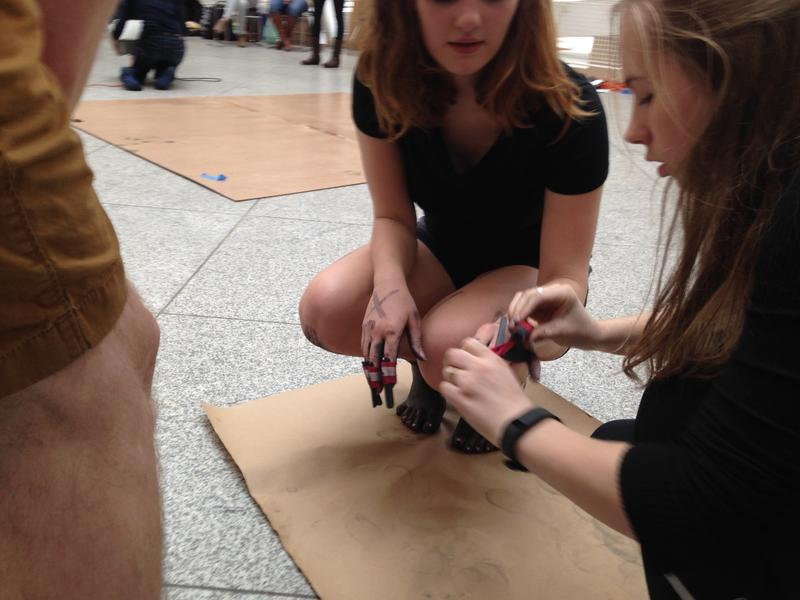 North Atlanta student Callie Nelson helps Hannah Keller remove charcoal from her fingers after the performance art challenge.