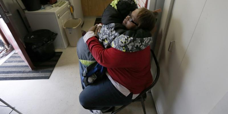 Debra Aldridge hugs and recites a prayer with her grandson, Mario Hendricks, before the child departed for a sleepover at a cousin's home, at her home on Chicago's South Side. Nationwide, there are 2.7 million grandparents raising grandchildren.