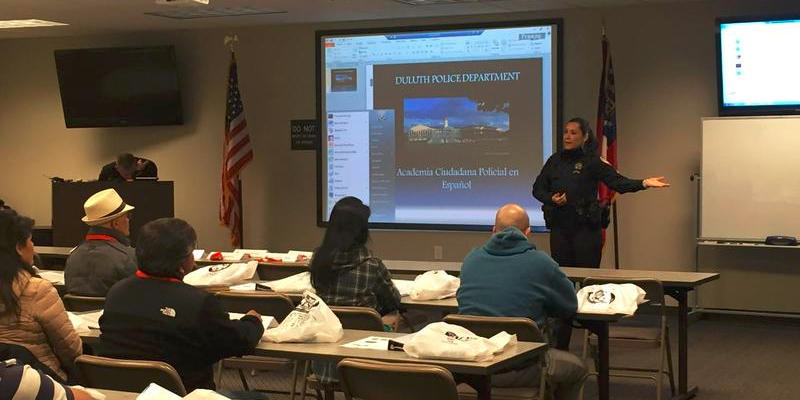 Police Corporal Ingrid Smith gives an introduction to the first Hispanic Citizens Police Academy.