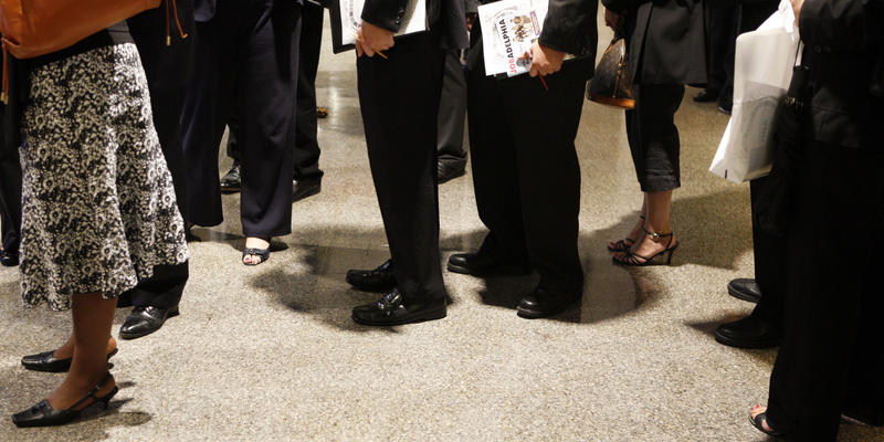 In this Sept. 10, 2009 photo, job hunters wait in line to meet with recruiters at a job fair in Philadelphia.