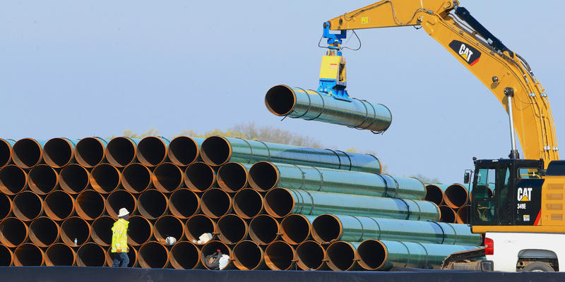 In this May 9, 2015 file photo, pipes for the proposed Dakota Access Pipeline are stacked at a staging area in Worthing, S.D.