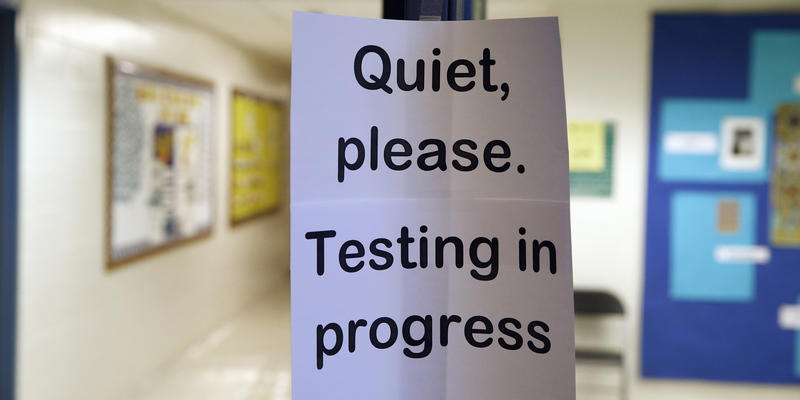 In this photo taken Jan. 17, 2016, a sign is seen at the entrance to a hall for a college test preparation class at Holton Arms School.