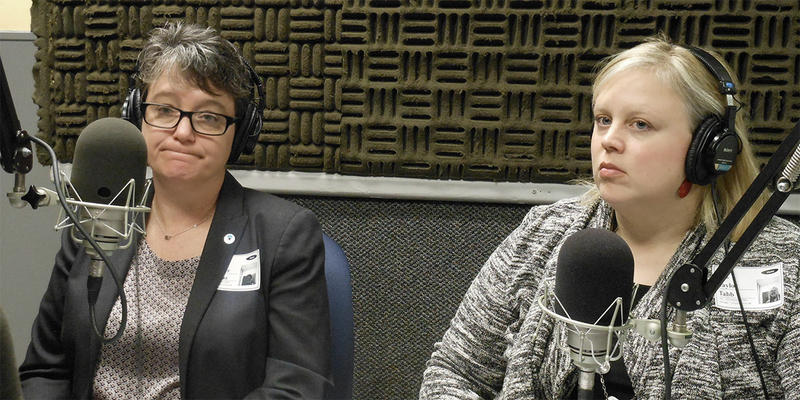 Jennifer Thomas, left, of the Georgia Commission on Family Violence, and Taylor Tabb of the Georgia Coalition Against Domestic Violence, spoke with Denis O'Hayer.