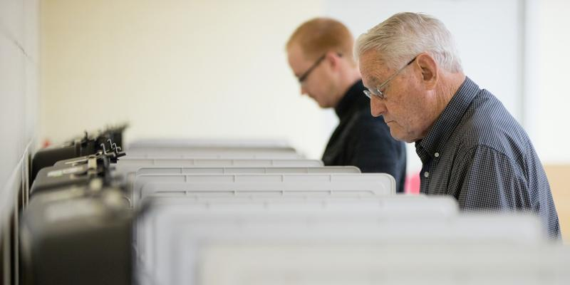 Jason Spell, left, and Huron Nichols, vote Tuesday in Lake Park, Georgia. About 90 percent of voting machines used in the state were bought in 2002 or earlier. Chris Famighetti, a voting rights researcher, said they appear to be in relatively good shape.
