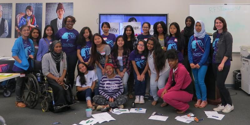 The young women of the 2015-16 New American Pathways extracurricular program pose with supporting staff and AmeriCorps member.