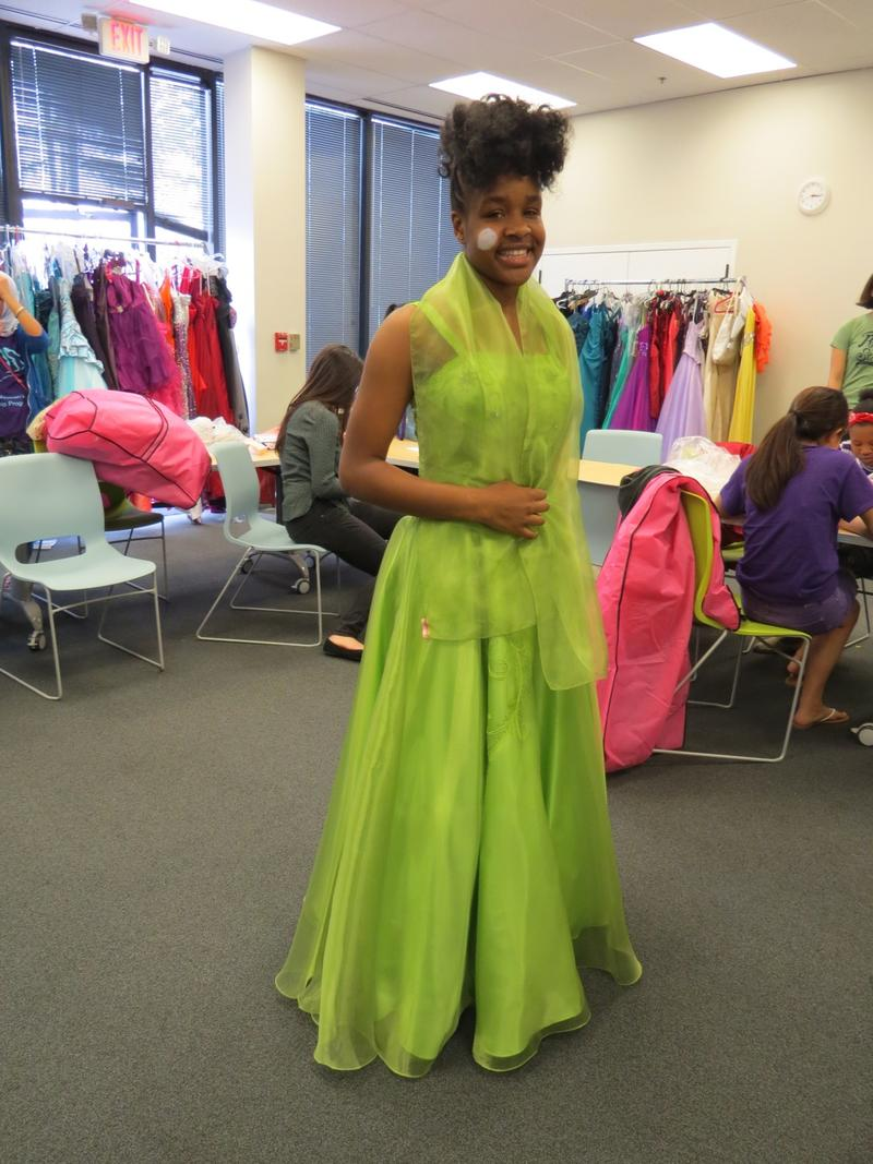 Sophomore Janette Niyongere models a dress she picked out through the New American Pathways extracurricular program.