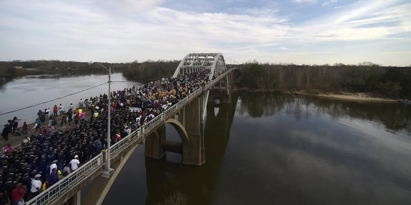 Last year, crowds of people took a symbolic walk across the Edmund Pettus Bridge in Selma, Alabama, to mark the 50th anniversary of ''Bloody Sunday.'' Thousands are expected to participate Sunday and re-enact the walk to mark the 51st anniversary.
