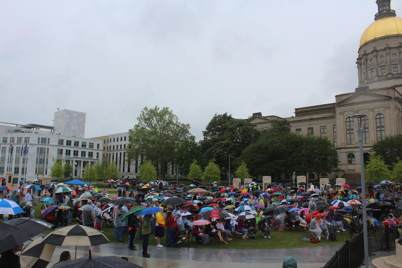 Churchgoers and pastors gather outside the State Capitol.