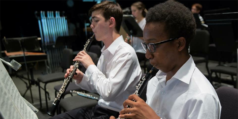 High school Junior Mekhi Gladden (right) is part of the Atlanta Symphony's Talent Development Program