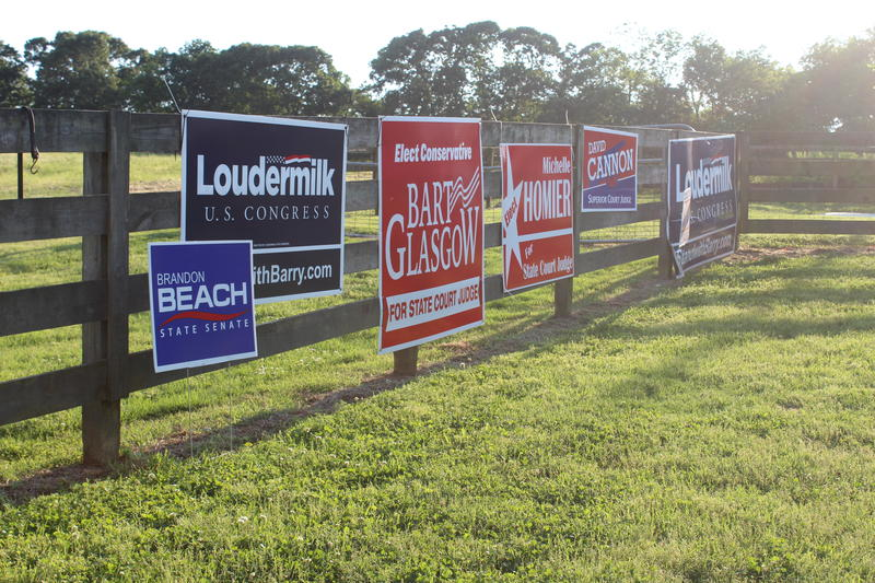 Campaign signs at the Cagle Family Farm candidate forum in Cherokee County.
