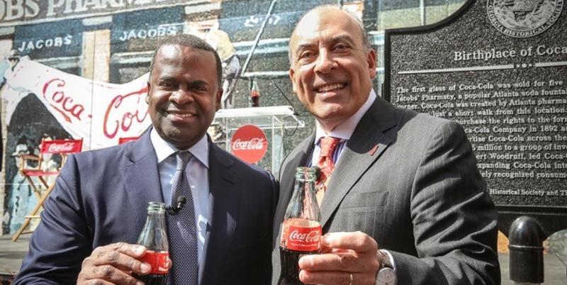 Atlanta Mayor Kasim Reed, left, and Coca-Cola Chairman Muhtar Kent have a Coke and a smile.