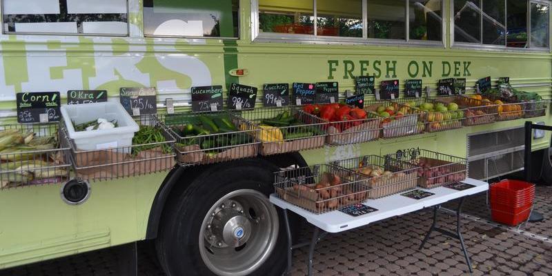 A converted school bus serves as a farmers market in DeKalb County.