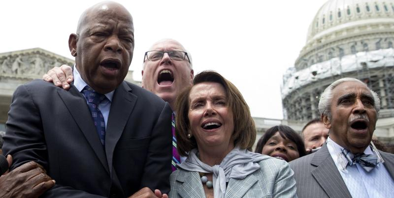 "From left, Rep. John Lewis, D-Ga., Rep. Joseph Crowley, D-N.Y., House Minority Leader Nancy Pelosi of Calif. and Rep. Charles Rangel, D-N.Y., sing ""We Shall Overcome"" on Capitol Hill in Washington, Thursday, June 23, 2016."