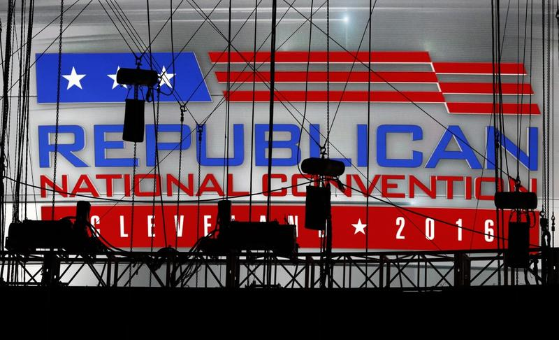 A Republican National Convention logo is seen though silhouetted production equipment on a huge video screen at Quicken Loans Arena for the Republican National Convention, Sunday, July 17, 2016, in Cleveland.
