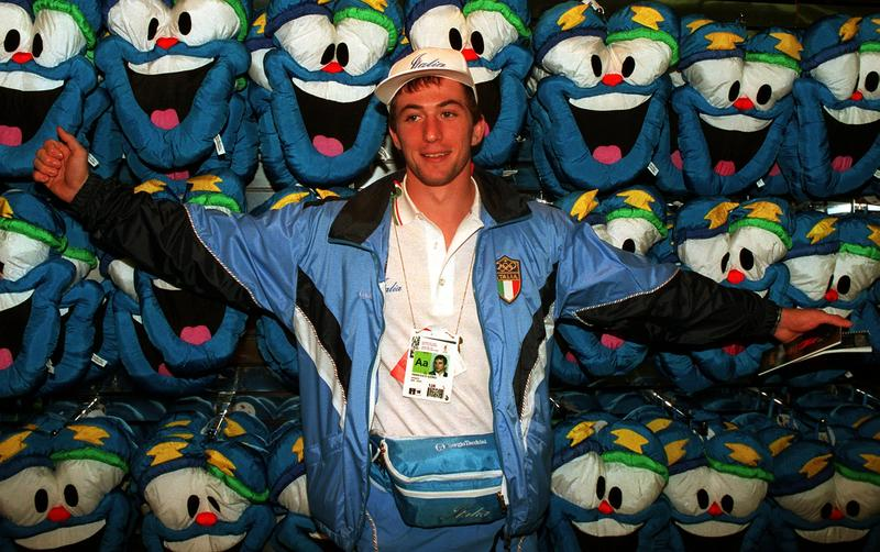 """Italian Judo team member Francesco Giorgi poses in front of a display of """"Izzy"""" mascot puppets in Atlanta, Monday, July 15, 1996. The 1996 Summer Games began on July 19."""